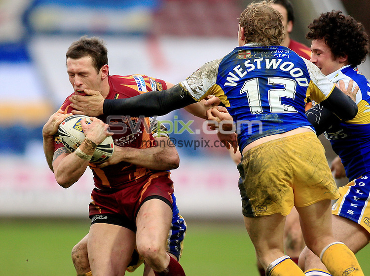Pix: Chris Mangnall /SWPix.com, Rugby League, Super League. 28/02/10 Huddersfield Giants v Warrington Wloves....picture copyright>>Simon Wilkinson>>07811267 706>>....Huddersfield's Shaun Lunt tackled by Warrington's Richie Myler Ben Westwood and Vinny Anderson