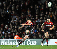 Watford, England. Owen Farrell of Saracens kicks a penalty during the Heineken Cup match between Saracens and Munster Rugby at the Vicarage Road on December 16, 2012 in Watford, England.