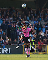 Dan Rowe of Wycombe Wanderers beats Dominic Calvert-Lewin of Northampton Town in the air during the Sky Bet League 2 match between Wycombe Wanderers and Northampton Town at Adams Park, High Wycombe, England on 3 October 2015. Photo by Andy Rowland.