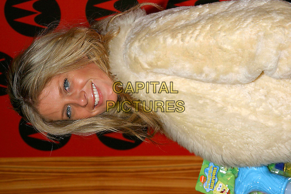 RACHEL HUNTER.Motorola's Sixth Anniversary Party to Benefit Toys For Tots held at the Music Box Theatre, Hollywood, California, USA, 2nd December 2004..portrait headshot.**UK SALES ONLY**.Ref: ADM.www.capitalpictures.com.sales@capitalpictures.com.©J.Wong/AdMedia/Capital Pictures .