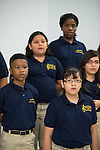 Members of The Rusk School & Houston Chamber Choir perform during The Rusk School ribbon cutting ceremony, April 7, 2014.