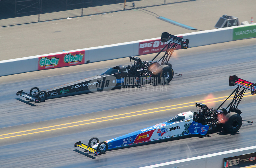 Jul 28, 2019; Sonoma, CA, USA; NHRA top fuel driver Brittany Force (near) alongside Mike Salinas during the Sonoma Nationals at Sonoma Raceway. Mandatory Credit: Mark J. Rebilas-USA TODAY Sports