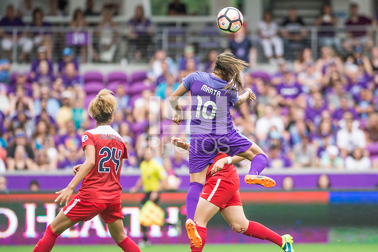 Orlando, FL - Saturday April 22, 2017: Estelle Johnson, Marta during a regular season National Women's Soccer League (NWSL) match between the Orlando Pride and the Washington Spirit at Orlando City Stadium.