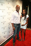 Ralph Lauren Model Chris Collins and Model Georgette Goldson attend The House of Rémy Martin® celebrates the national launch of Rémy Martin® V - the brand's first CLEAR spirit at LAVO, NY 7/12/11