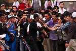 HAIKOU, CHINA - OCTOBER 31:  Hong Kong actor Simon Yam saludates fans on the 14th hole during day five of the Mission Hills Start Trophy at Mission Hills Resort on October 31, 2010 in Haikou, China.  The Mission Hills Star Trophy is Asia's leading leisure liflestyle event and features Hollywood celebrities and international golf stars. Photo by Victor Fraile / The Power of Sport Images