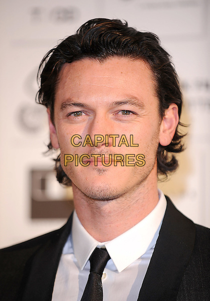 LUKE EVANS .attending the Independent Film Awards 2009, The Brewery, Chiswell Street, London, England UK, .6th December 2009. .portrait headshot black tie moustache mustache facial hair .CAP/BEL.©Tom Belcher/Capital Pictures.