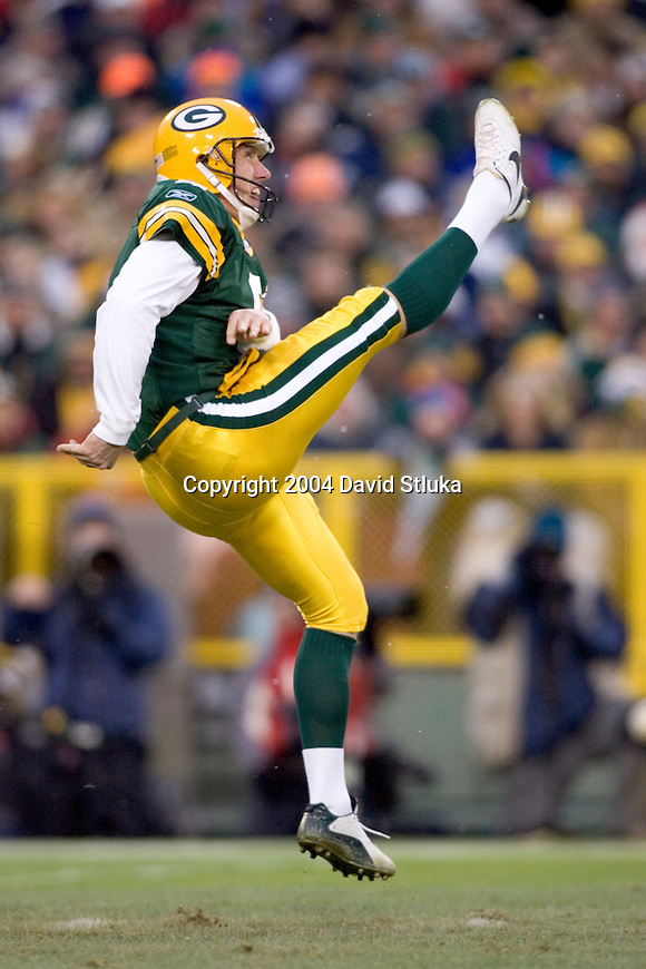 Punter Bryan Barker #9 of the Green Bay Packers punts the ball against the Detroit Lions at Lambeau Field on December 12, 2004 in Green Bay, Wisconsin. The Packers defeated the Lions 16-13. (Photo by David Stluka)