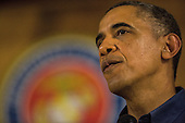 United States President Barack Obama pauses while speaking to current and retired members of the U.S. military and their families as they eat a Christmas Day meal in the Anderson Hall mess hall at Marine Corps Base Hawaii at Kaneohe Bay in Kaneohe Bay, Hawaii, USA, on 25 December 2013. <br /> Credit: Kent Nishimura / Pool via CNP