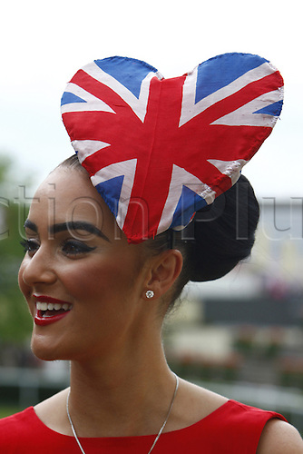 21.06.12 Ascot, Windsor, ENGLAND: .A racegoer in special hat and dress during Ladies Day Royal Ascot Festival at Ascot racecourse on June 21, 2012 in Ascot, England..