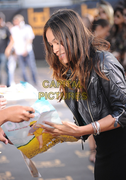 "ROSARIO DAWSON.The Universal Pictures' L.A. Premiere of ""Bruno"" held at the Grauman's Chinese Theatre in Hollywood, California, USA. .June 25th, 2009.half length black leather jacket profile signing autograph silver bracelets .CAP/DVS.©Debbie VanStory/Capital Pictures."