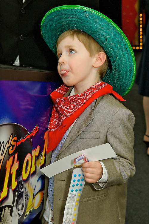 Boy wearing cowboy hat and bandanna at a rodeo themed  Mitzvah party at Tribeca Rooftop in New York.