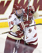 Bill Arnold (BC - 24) and Steven Whitney (BC - 21) celebrate Whitney's goal. - The Boston College Eagles defeated the visiting Boston University Terriers 5-2 on Saturday, December 4, 2010, at Conte Forum in Chestnut Hill, Massachusetts.