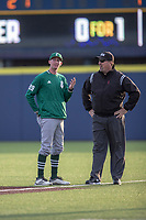 Eastern Michigan Eagles head coach Jonathan Roof argues with the first base umpire Jason Smith during the NCAA baseball game against the Michigan Wolverines on May 8, 2019 at Ray Fisher Stadium in Ann Arbor, Michigan. Michigan defeated Eastern Michigan 10-1. (Andrew Woolley/Four Seam Images)