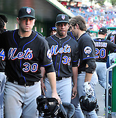 New York Mets catcher Josh Thole (30) and pitcher Jenrry Mejia (32) leave the dug-out following their team's 13 - 3 loss to the Washington Nationals at Nationals Park in Washington, D.C. on Monday, September 6, 2010. .Credit: Ron Sachs / CNP.(RESTRICTION: NO New York or New Jersey Newspapers or newspapers within a 75 mile radius of New York City)