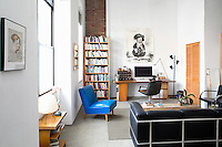 blue leather chair<br /> <br /> French artist, Jacques Flechemuller and his designer wife, Puanani, live half the year in this Brooklyn, New York loft and the other half in the south of France.  The loft is minimally decorated with artwork, finds from the street and Craig's list as well pieces made by Puanani. The space also includes a relaxing Zen mezzanine.