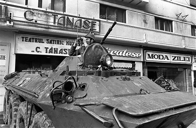 ROMANIA, Calea Victoriei, Bucharest, 23.12.1989<br /> People rise against Ceausescu. The dictator has fled the city on dec. 22. BTR-80 armoured personnel carrier at the Tanase theatre.<br /> © Andrei Pandele / EST&OST