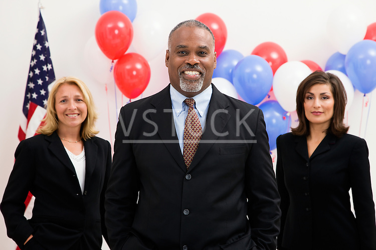 USA, Illinois, Metamora, Portrait of politicians in front of US flag and balloons