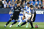 CD Leganes' Luciano Neves (c) and Real Madrid's Sergio Ramos (l) and Nacho Fernandez during La Liga match. April 5,2017. (ALTERPHOTOS/Acero)