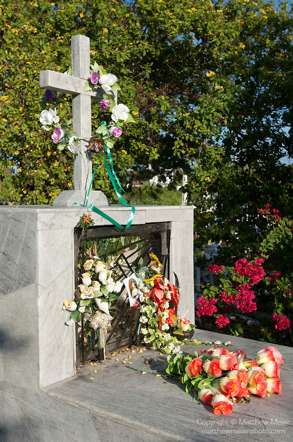 Puerto Ayora, Santa Cruz Island, Galapagos, Ecuador; flowers and tombstones at the Municapal Cemetery at the southern end of Puerto Ayora , Copyright © Matthew Meier, matthewmeierphoto.com All Rights Reserved