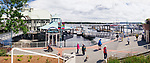 Panoramic view of people walking on Nanaimo Waterfront by the harbourside patio of Lighthouse bistro Vancouver Island, British Columbia, Canada 2017