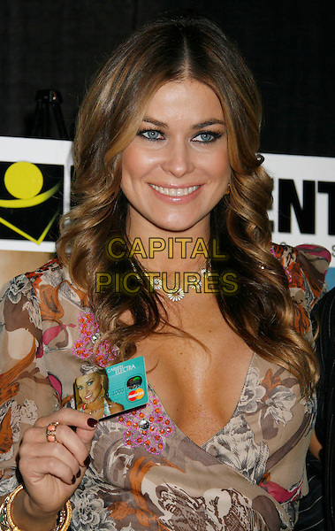 "CARMEN ELECTRA.Carmen Electra Launches the ""Carmen Electra Prepaid MasterCard"" held at Red Pearl Kitchen, Hollywood, California, USA..October 25th, 2006.Ref: ADM/RE.half length cleavage beige pattern dress credit card necklace bracelet.www.capitalpictures.com.sales@capitalpictures.com.©Russ Elliot/AdMedia/Capital Pictures."