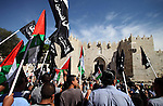 "Palestinian protesters hold their national flags during a demonstration marking the 66th anniversary of the ""Nakba,"" meaning catastrophe, when many Palestinians fled or were expelled from their towns and villages during the war of Israel's foundation in 1948, at Damascus Gate in Jerusalem's Old City May 15, 2014. An Israeli police spokesman said on Thursday that 5 Palestinian protesters were detained during the unauthorized demonstration in Jerusalem's Old City, where stones were thrown at policemen and an Israeli flag was burnt. Also on Thursday, Israeli forces shot dead two Palestinians during a stone-throwing protest marking the ""Nakba"" in the occupied West Bank. Photo by Saeed Qaq"
