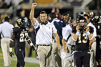 12 November 2011:  FIU Head Football Coach Mario Cristobal reacts to T.Y. Hilton's 97-yard punt return for a touchdown in the second quarter as the FIU Golden Panthers defeated the Florida Atlantic University Owls, 41-7, to win the annual Shula Bowl game, at FIU Stadium in Miami, Florida.