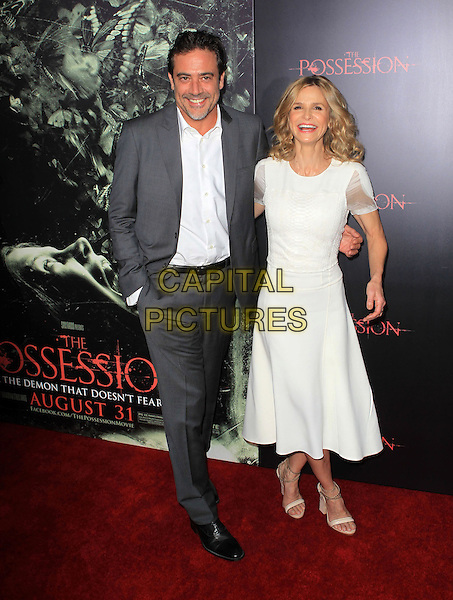 "Jeffrey Dean Morgan & Kyra Sedgwick.""The Possession"" Los Angeles Premiere held at Arclight Cinemas, Hollywood, California, USA..August 28th, 2012.full dress white shirt grey gray suit jacket sheer stubble facial hair  smiling hand in pocket .CAP/ADM/KB.©Kevan Brooks/AdMedia/Capital Pictures."