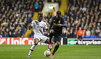 Nabil Dirar of Monaco controls the ball under pressure from Joshua Onomah of Tottenham Hotspur during the UEFA Europa League group match between Tottenham Hotspur and Monaco at White Hart Lane, London, England on 10 December 2015. Photo by Andy Rowland.
