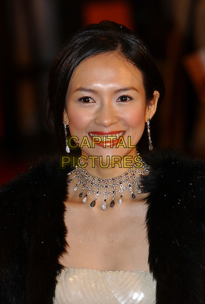 ZIYI ZHANG.Arrivals at The Orange British Academy Film Awards, .(BAFTA's) Odeon Leicester Square, London, England,.19 February 2006.bafta baftas portrait headshot white sequined dress black fur jacket silver necklace.Ref: FIN.www.capitalpictures.com.sales@capitalpictures.com.©Steve Finn/Capital Pictures.