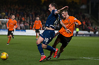 27th December 2019; Dens Park, Dundee, Scotland; Scottish Championship Football, Dundee Football Club versus Dundee United; Paul McGowan of Dundee challenges for the ball with Jamie Robson of Dundee United  - Editorial Use