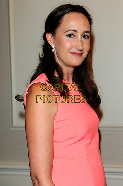 Sophie Kinsella.Romantic Novel of the Year Awards, the Royal Air Force Club, The Presidents Room, 128 Piccadilly, London, England..February 26th, 2013.half length pink salmon sleeveless dress  side .CAP/CJ.©Chris Joseph/Capital Pictures.