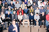 With his wife (white sweater near center) and three of his four kids watching from the front row, Republican presidential candidate and New Jersey governor Chris Christie speaks at his final New Hampshire town hall of the primary election at the St. George Greek Orthodox Cathedral in Manchester, New Hampshire, on Mon., Feb., 8, 2016.