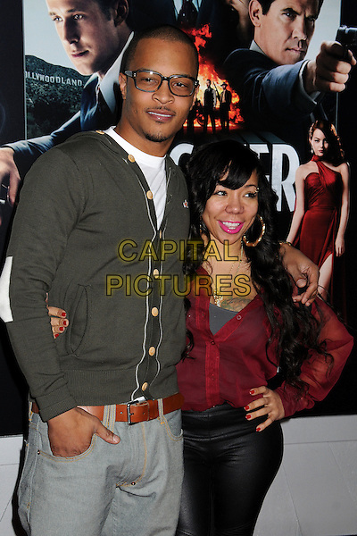 "T.I. (T.I.P.) (Clifford Joseph Harris, Jr.) & Tiny (Tameka Cottle).""Gangster Squad"" Los Angeles Premiere held at Grauman's Chinese Theatre, Hollywood, California, USA..January 7th, 2013.half length grey gray cardigan glasses red top hand on hip married husband wife arm over shoulder   .CAP/ADM/BP.©Byron Purvis/AdMedia/Capital Pictures."