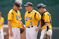 VCU Rams head coach Paul Keyes #5 (center) has a chat with Kyle Haynes #30 and Taylor Perkins #26 at the Charlottesville Regional of the 2010 College World Series at Davenport Field on June 5, 2010, in Charlottesville, Virginia.  The Red Storm defeated the Rams 8-6.  Photo by Brian Westerholt / Four Seam Images