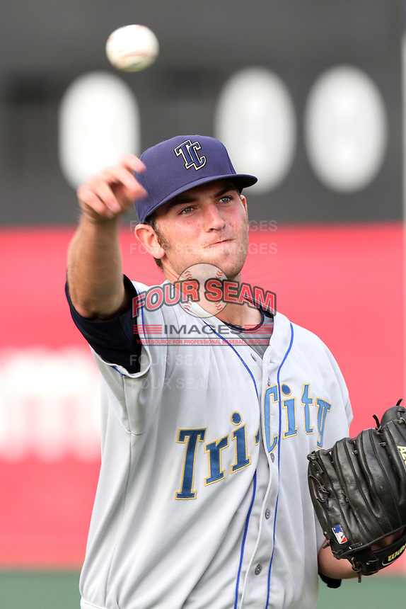 Tri-City Dust Devils pitcher Chris Jensen #18 warms up before pitching against the Everett Aquasox at Everett Memorial Stadium on August 13, 2011 in Everett,Washington. Everett defeated Tri-City 6-4.(Larry Goren/Four Seam Images)