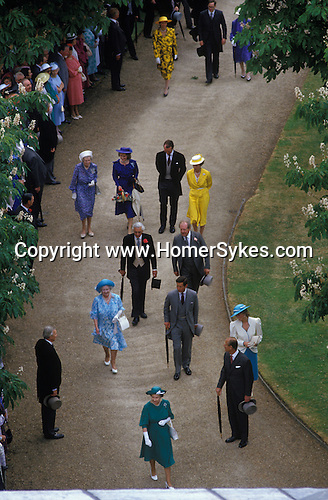 Buckingham Palace Garden Party Queen Mother leads the Royal family back to Buckingham Palace.  The English Season published by Pavilon Books 1987