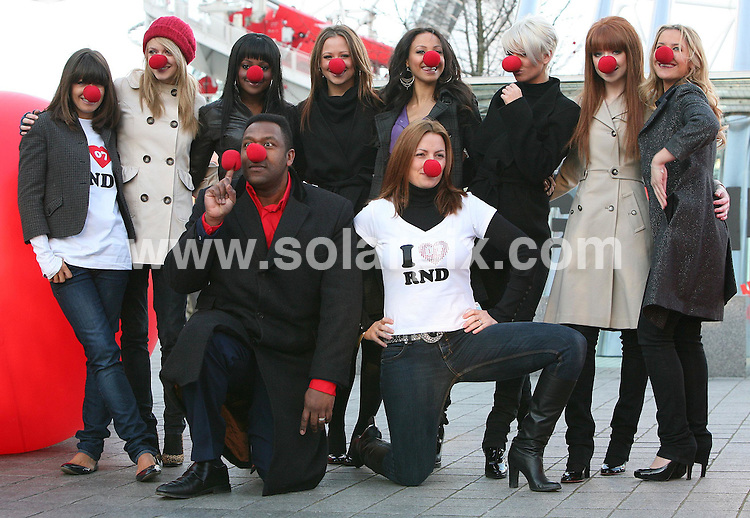 ALL ROUND PICTURES FROM SOLARPIX.COM.WORLDWIDE SYNDICATION RIGHTS..Comic Relief launch Red Nose Day 2007 with the help of Girls Aloud and The Sugababes at the London Eye on 31.01.07..This pic: BACK ROW (L to R) Claudia Winkleman, Ferne Cotton, Keisha Buchanan, Kimberley Walsh, Amelle Berrabah, Sarah Harding, Nicola Roberts and Heidi Range..FRONT (L to R) Lenny Henry and Davina McCall...DATE: 31.01.07-JOB REF: 3296-SSD.**MUST CREDIT SOLARPIX.COM OR DOUBLE FEE WILL BE CHARGED**