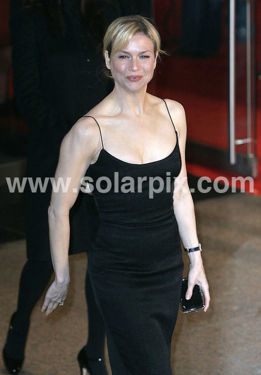 **ALL ROUND PICTURES FROM SOLARPIX.COM**.WORLDWIDE SYNDICATION RIGHTS EXCLUDING - .UK NEWSPAPER PUBLICATION - UK MAGAZINE PUBLICATION ONLY AND NO PUBLICATION IN FRANCE, SCANDINAVIA, AUSTRALIA AND GERMANY**.Actress Renee Zellweger attends the UK film premiere of Miss Potter at the Odeon Cinema , Leicester Square , London ..The movie is based on the life of author Beatrix Potter . .DATE:03/12/2006-JOB REF: 3132-SFE.**MUST CREDIT SOLARPIX.COM OR DOUBLE FEE WILL BE CHARGED**