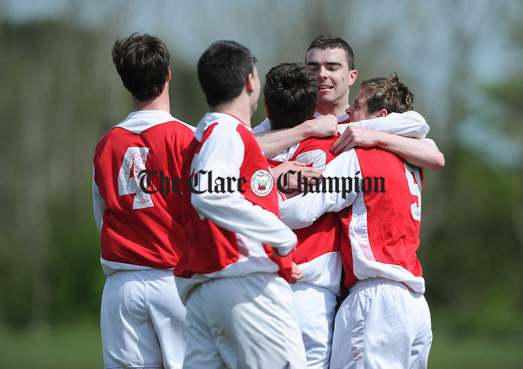 Goal scorer Ronan Mc Cormack(10) of Newmarket is congratulated by team mates during their game against Avenue United at Lees road. Photograph by John Kelly.