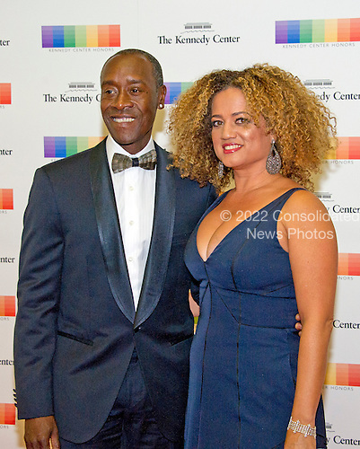 American actor Don Cheadle and his wife, Bridgid Coulter, arrive for the formal Artist's Dinner honoring the recipients of the 39th Annual Kennedy Center Honors hosted by United States Secretary of State John F. Kerry at the U.S. Department of State in Washington, D.C. on Saturday, December 3, 2016. The 2016 honorees are: Argentine pianist Martha Argerich; rock band the Eagles; screen and stage actor Al Pacino; gospel and blues singer Mavis Staples; and musician James Taylor.<br /> Credit: Ron Sachs / Pool via CNP