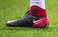 The personalised Nike Magista football boots of Shkodran Mustafi of Arsenal displaying 'BACK ON TOP' during the Premier League match between Bournemouth and Arsenal at the Goldsands Stadium, Bournemouth, England on 14 January 2018. Photo by Andy Rowland.