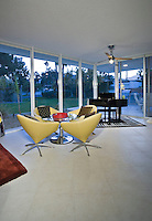 Mid-century living room with grand piano in background
