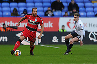 Laurent Depoitre of Huddersfield Town holds up the ball from Josh Vela of Bolton Wanderers during Bolton Wanderers vs Huddersfield Town, Emirates FA Cup Football at the Macron Stadium on 6th January 2018