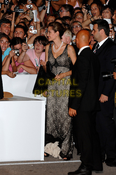 "ANGELINA JOLIE.""The Assassination of Jesse James by the Coward Robert Ford"" premiere.64th Venice Film Festival.2nd September 2007, Italy .La Biennale di Venezia, signing autograph autographs full length.Ref: CAP/PL.©Phil Loftus/Capital Pictures"