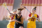 Los Angeles, CA 02/09/13 - Kaila Sommi (USC #12), Paige Bonomi (USC #16) and Alyssa Leonard  (Northwestern #2) in action during the Northwestern vs USC NCAA Women Lacrosse game at the Los Angeles Colliseum.