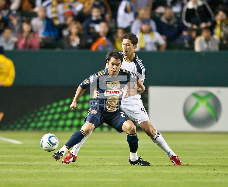 CARSON, CA – April 2, 2011: Philadelphia Union forward Carlos Ruiz (20) shields LA Galaxy defender Omar Gonzalez (4) from the pass during the match between LA Galaxy and Philadelphia Union at the Home Depot Center, March 26, 2011 in Carson, California. Final score LA Galaxy 1, Philadelphia Union 0.