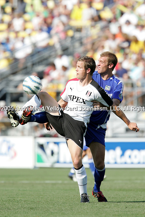 30 July 2005: Heider Helguson (front) is challenged for the ball by Jimmy Conrad (behind). Major League Soccer's All-Stars defeated Fulham FC of the English Premier League 4-1 at Columbus Crew Stadium in Columbus, Ohio in the 2005 Sierra Mist MLS All-Star Game..
