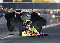 Feb 11, 2017; Pomona, CA, USA; NHRA top fuel driver Troy Coughlin Jr gets sideways in his dragster during qualifying for the Winternationals at Auto Club Raceway at Pomona. Mandatory Credit: Mark J. Rebilas-USA TODAY Sports