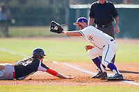 Spencer Angelis (11) of the High Point Panthers waits for a pick-off throw as Brian Bien (3) of the Bowling Green Falcons dives back towards first base at Willard Stadium on March 9, 2014 in High Point, North Carolina.  The Falcons defeated the Panthers 7-4.  (Brian Westerholt/Four Seam Images)